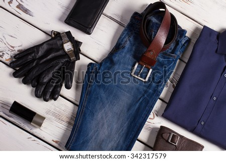 Stylish set of men's clothing on a beautiful background. Branded clothing and accessories. - stock photo