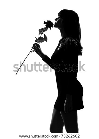 stylish sexy silhouette caucasian beautiful woman smelling a flower rose  on studio isolated white background - stock photo