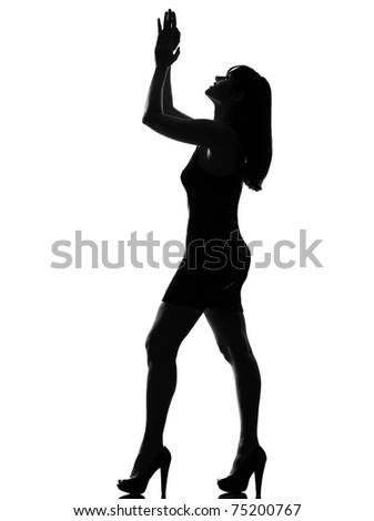 stylish silhouette caucasian beautiful woman applauding looking up full length on studio isolated white background - stock photo