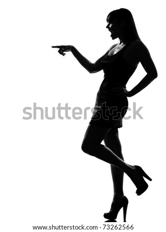 stylish silhouette caucasian beautiful woman laughing poiting full length on studio isolated white background