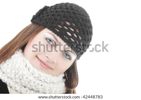 Stylish smiling young woman in black hat and knitted scarf isolated on white with copy space - stock photo