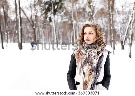 stylish street fashion concept - young slim blond woman with purple lips and curly hair having fun. hair care, fashion bob hairstyle. fashion blogger girl outdoors - stock photo