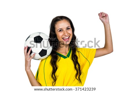 Stylish supporting woman holding football ball rejoicing on white screen
