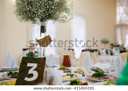 stylish tastefully decorated with flowers and accessories hall of the restaurant to celebrate wedding - stock photo