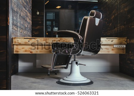 Stylish Vintage Barber Chair In Wooden Interior Barbershop Theme