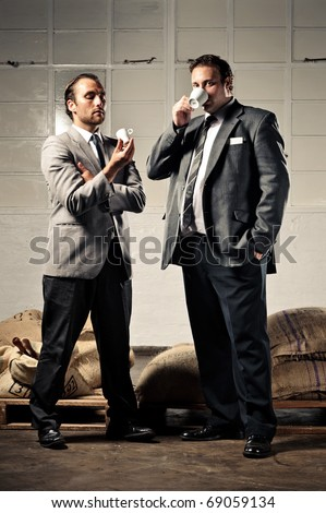 stylish vintage businessmen are confident and have coffee - stock photo
