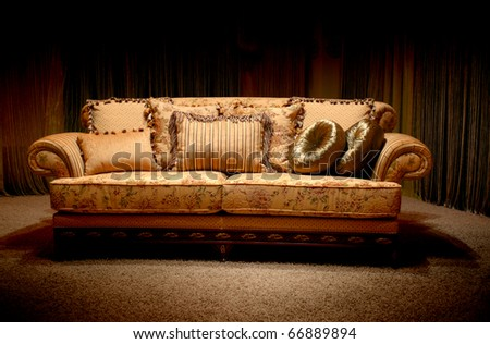Stylish vintage sofa with pillows - stock photo