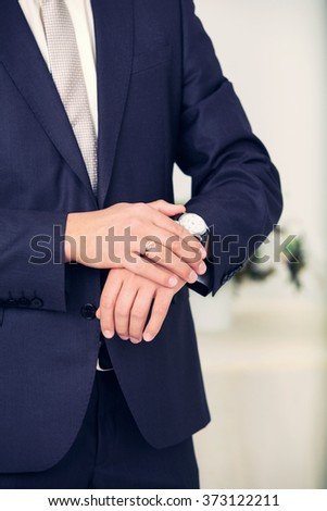 stylish watch on a hand at the man
