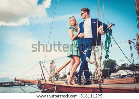 Stylish wealthy couple on a luxury yacht  - stock photo