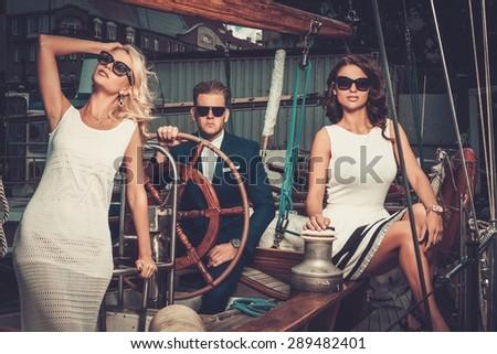 Stylish wealthy friends on a luxury yacht  - stock photo