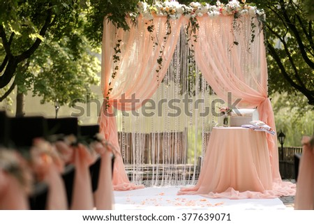 Stylish wedding arch in the park on the ceremony - stock photo
