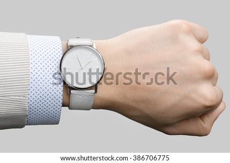 stylish white wristwatches on the hand businessman - stock photo
