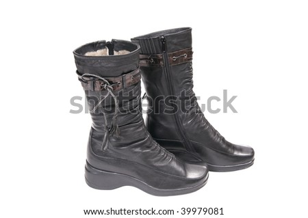 Stylish winter boots isolated on a white background.