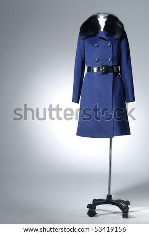 Stylish winter coat isolated on the white background - stock photo