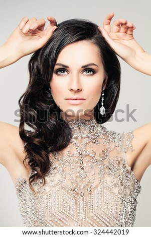 Stylish Woman.Beautiful Female Face. Makeup, Curly Hair and Jewelry