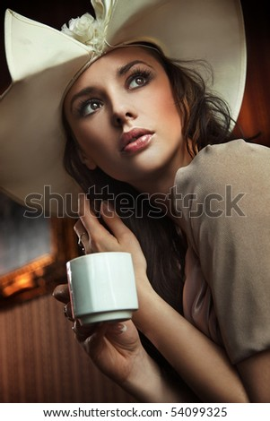 Stylish woman drinking coffee - stock photo
