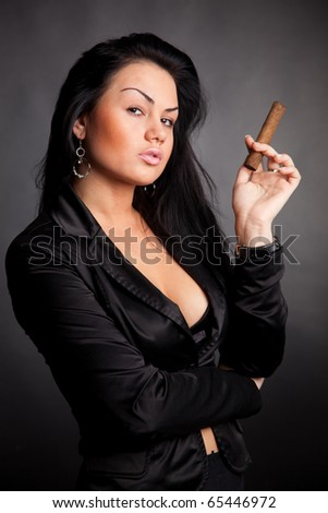Stylish woman in black with cigar; - stock photo