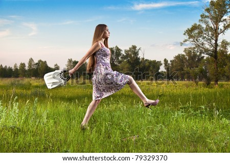 Stylish woman in dress with bag outdoor. Summer shopping time - stock photo