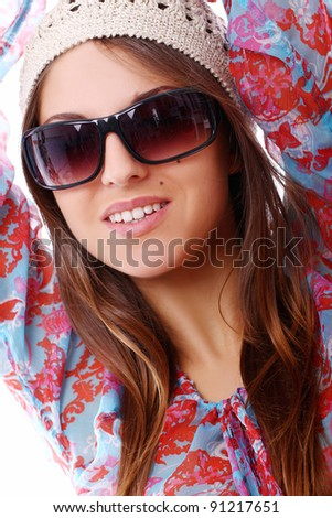 Stylish woman in sunglasses over white background