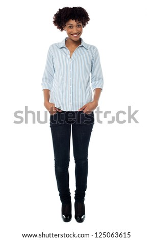 Stylish woman in trendy clothing. Full length portrait on white.