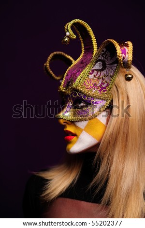 stylish woman in violet half mask isolated on dark purple