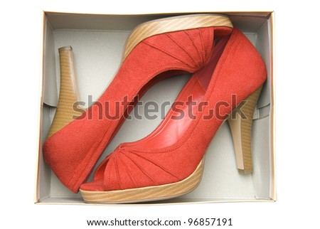 Stylish woman's shoes in a box on white background - stock photo