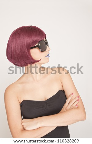 Stylish Woman side view with grey background - stock photo