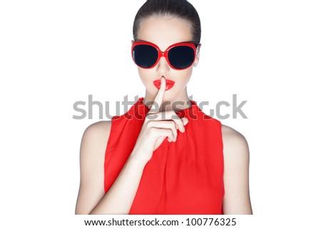 Stylish woman wearing dark sunglasses - stock photo