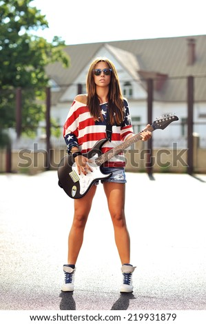 Stylish woman with electric guitar - stock photo