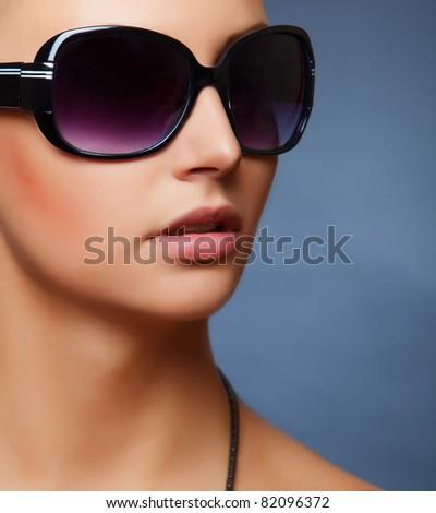 Stylish women's sunglasses, close up studio isolated shot - stock photo