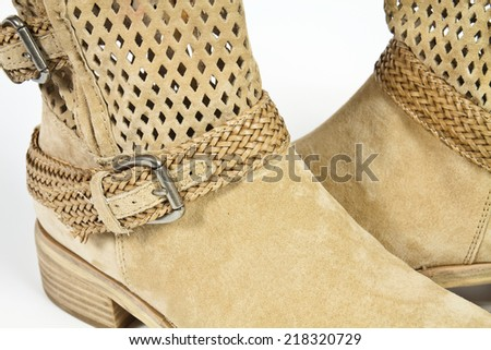 Stylish womens boots beige leather with metal buckles