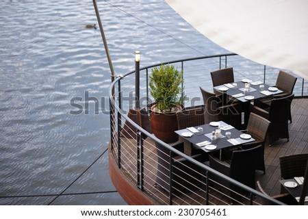 Stylish wooden outdoors cafe interior  - stock photo