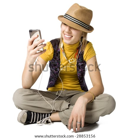 Stylish young adult listening to music on an MP3 player. - stock photo