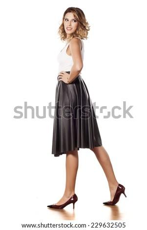Stylish young beautiful woman in a long black skirt - stock photo