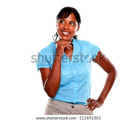 Stylish young black woman smiling on blue shirt against white background - copyspace - stock photo