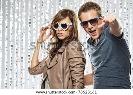 Stylish young couple in the nightclub - stock photo