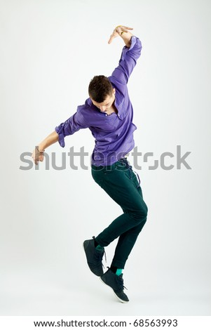 Stylish young fashion dancer, posing for the camera - stock photo