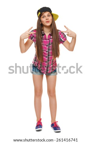 Stylish young girl in a cap, a shirt and denim shorts. Street style teenager, lifestyle, isolated on white background