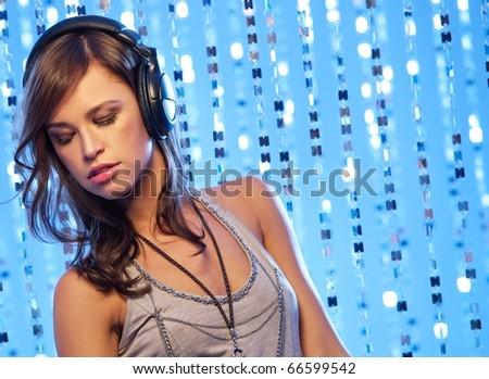Stylish young girl with headphones - stock photo