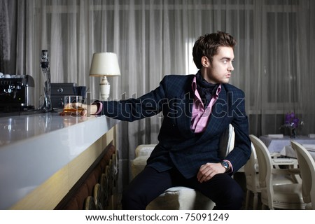 Stylish young man in a restaurant - stock photo
