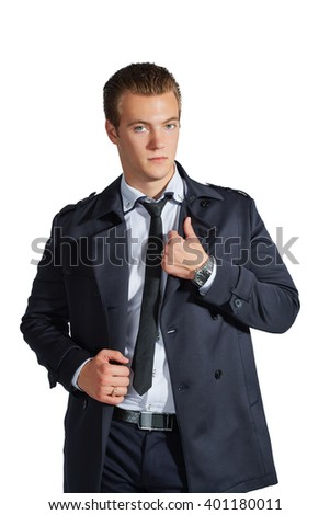 Stylish young man in formal clothes. Businessman. Isolated on a white background.