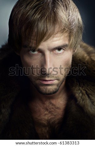 Stylish young man portrait. Looking at camera - stock photo