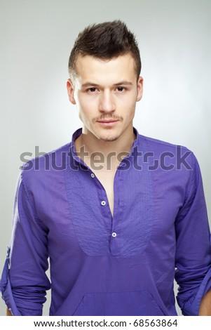 Stylish young man posing and looking at camera - stock photo