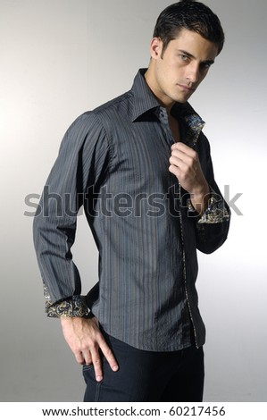 Stylish young man posing and looking at camera isolated on white - stock photo