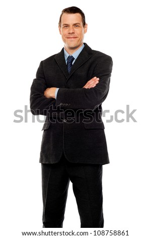 Stylish young man posing with crossed arms. Business concept - stock photo