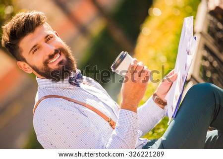 Stylish young man with a beard, a walk in the park - stock photo
