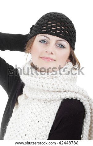 Stylish young woman in black hat and knitted long scarf isolated on white with copy space - stock photo