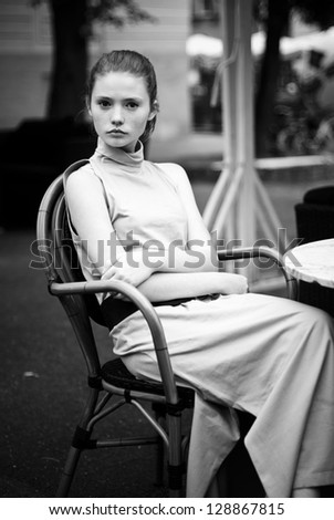 Stylish young woman in old city. black and white photo in retro style - stock photo