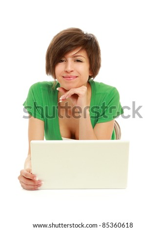 Stylish young woman lying with laptop on floor isolated - stock photo