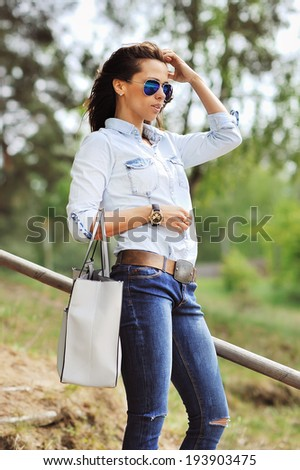 Stylish young woman - outdoor portrait  - stock photo